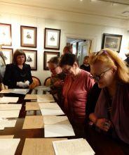 Гости вечера осматривают новый комплекс документов И.С. Тургенева